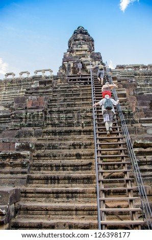 Tourist family visiting Pre Rup temple, Angkor, Cambodia