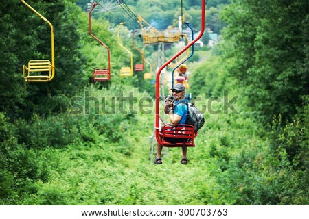 Tourist going on Cable car funicular from the mountain Kizilovka to the lake in Atazhukinsky garden in Nalchik