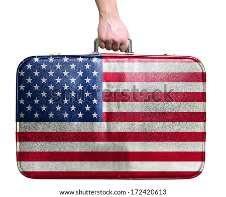 Tourist hand holding vintage leather travel bag with flag of United States of America