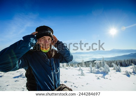 tourist in winter mountains