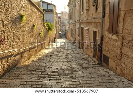 Tourist journey uphill through the streets of Rovinj, a quiet and charming place. Full of secrets holidays in Croatia.