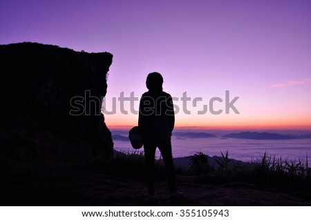 Tourist looking sunrise and sea of fog at Phu Chi Fa in Chiangrai, Thailand.