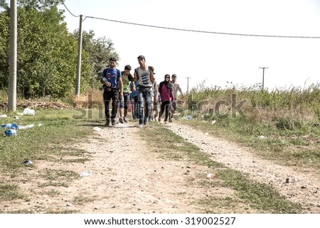 TOVARNIK, CROATIA - SEPTEMBER 19: Refugees walk across the border from Serbia to Croatia on September 19, 2015 in Tovarnik, Croatia.