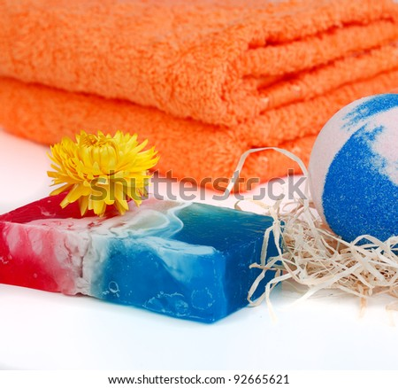 Towels and soap isolated on white