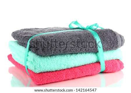 Towels tied with ribbon isolated on white
