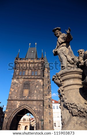 Tower and statue at the Charles Bridge in Prague, Czech Republic