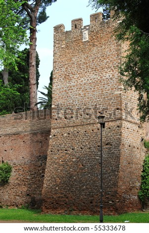 Tower in surrounding walls of Rome, Italy