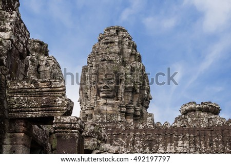 Towers with faces in Angkor Wat, temple complex in Cambodia and the largest religious monument in the world. UNESCO World Heritage Site.