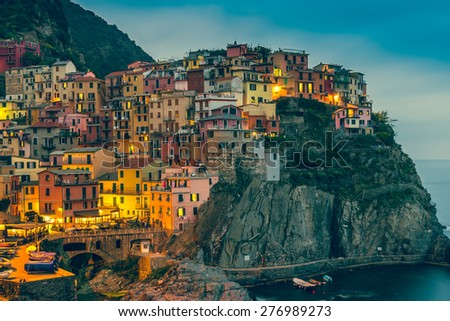 Town on the rocks at night Liguria Italy