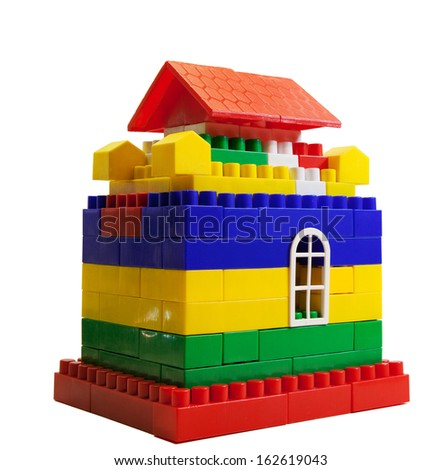 toy house out of colored blocks isolated on a white background