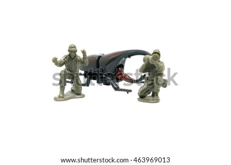 Toy soldiers save hercules beetle toys on white background