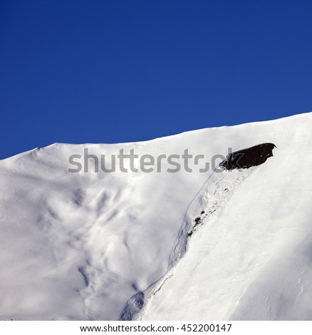 Trace of avalanche on off-piste slope in sunny day. Caucasus Mountains, Georgia, region  Gudauri.