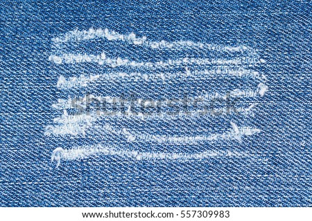 https://thumb10.shutterstock.com/display_pic_with_logo/1769528/557309983/stock-photo-trace-on-denim-ripped-jeans-destroyed-torn-blue-denim-background-close-up-blue-jean-texture-557309983.jpg