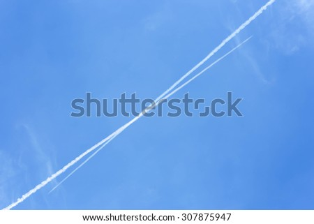 Traces acrossof planes tail in the sky