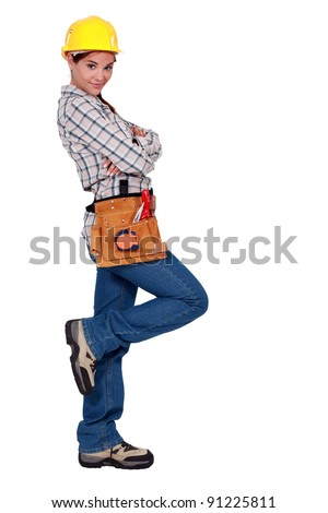 Tradeswoman leaning against an invisible wall