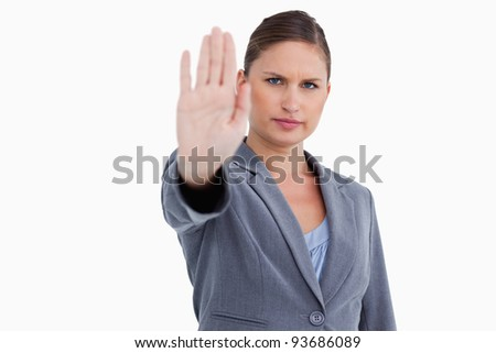 Tradeswoman signalizing stop against a white background