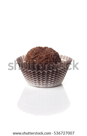 Traditional Brazilian candy brigadier, called in Portuguese  brigadeiros isolated over white background.
