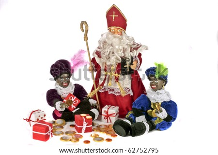 Traditional dutch culture: Santa-Claus and Two black Piet with presents and money at 5th december