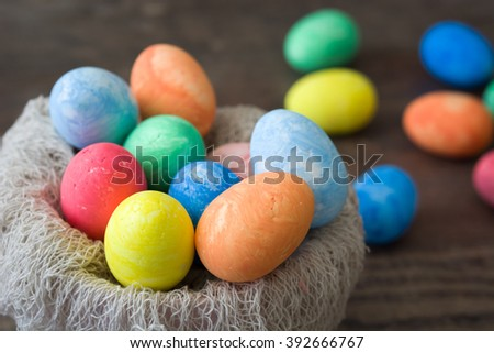 Traditional Easter eggs in a nest wooden background