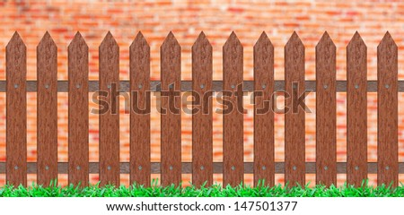 traditional fence with grass & brick wall background