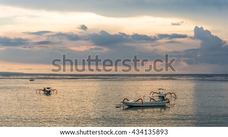 Traditional fisherman indonesian boats in the sunset light