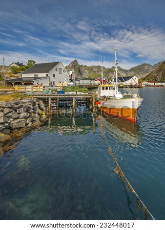Traditional fishing boats in scenic harbor on Lofoten islands in Norway
