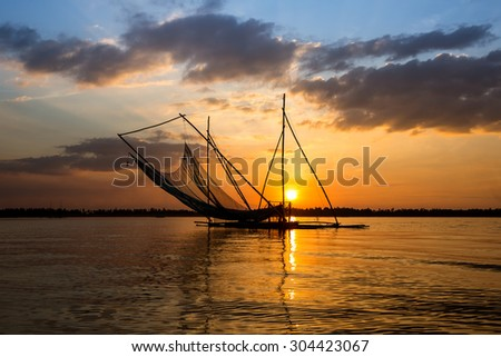 Traditional fishing tool of Thailand in sunset.