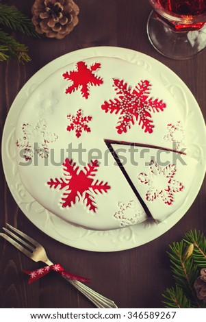 Traditional fruitcake on  Christmas table , top view, toned