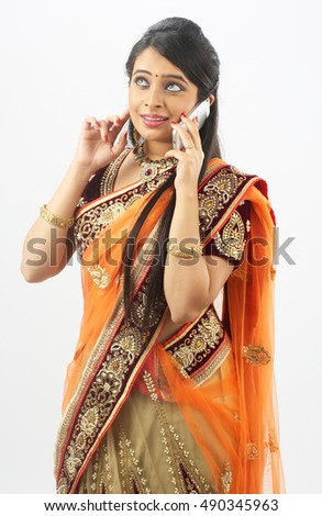 Traditional Indian woman talking on cellphone