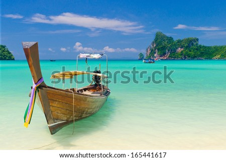 Traditional Longtail boat on the Loh Dalum beach, Phi-Phi Don island,  Thailand