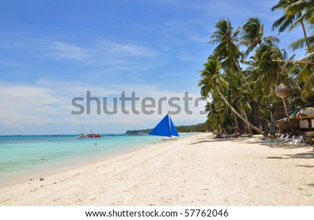 traditional paraw sailing boat on white beach on boracay island. philippines