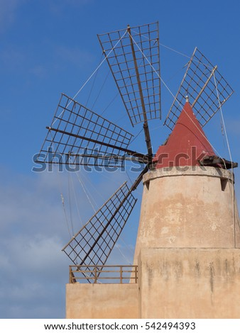 Traditional salt manufacturing windmill in salt Pans between Trapani and Marsala, Laguna Stagnone, Province of Trapani, Sicily, Italy