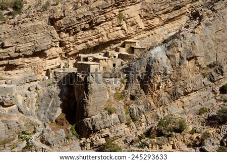 Traditional stone houses in a small cliff hamlet near Sroot in the Jebel Akhdar mountains of the Sultanate of Oman.