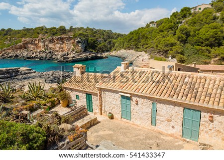 Traditional stone houses in Cala S'Almonia, Mallorca island, Spain