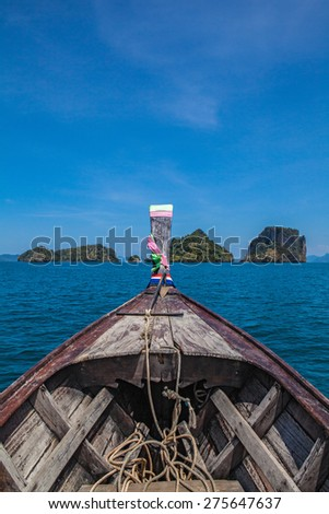Traditional thai long tail boat in a beautiful Andaman sea tropical island.
