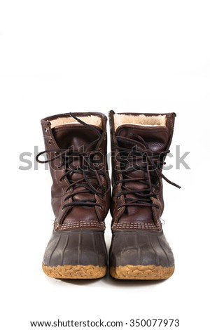 Traditional warm leather and rubber gum boots, also known as duck boots.
