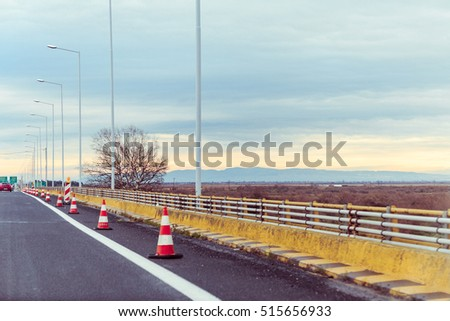 Traffic cones showing caution for maintenance of the road