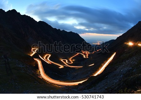 Traffic trails on Transfagarasan pass at night. Crossing Carpathian mountains in Romania, Transfagarasan is one of the most spectacular mountain roads in the world