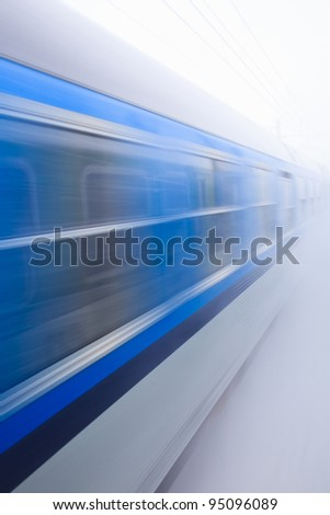 Train going fast in a snow storm