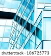 transparent glass wall of skyscraper - stock photo