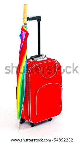 Travel bag and umbrella - isolated on white background.