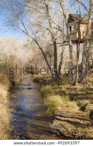 Treehouse and mountain stream in the rural Utah, USA