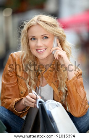 Trendy city girl talking on the phone