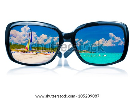 Trendy sunglasses with  a reflection of a tropical beach and sailing boats  isolated on white