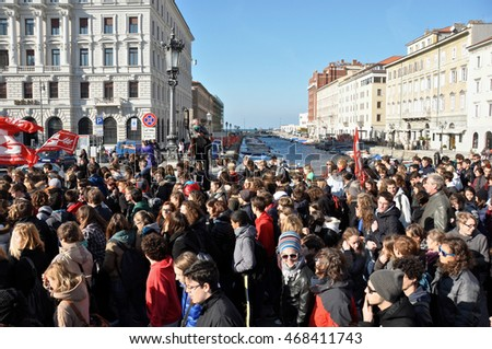Trieste, Italy - November 14, 2012: Students demonstrate near the Canal of Ponterosso against austerity, dancing,shouting slogans and waving banners.editorial use