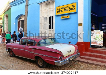 TRINIDAD, CUBA - JAN 19, 2016: Vintage Chevrolet Biscayne in front of La Bodeguita Del Medio in Trinidad, Cuba. This is a replica of the bar in Havana that is credited with the invention of the Mojito