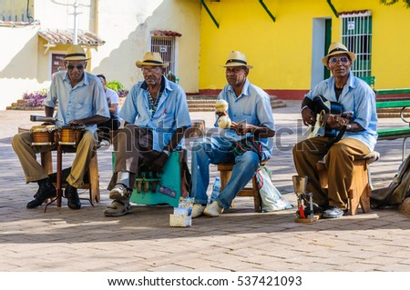 TRINIDAD, CUBA - MARCH 25, 2016: Afrocuban musicians playing on the street in the UNESCO World Heritage old town of Trinidad, Cuba