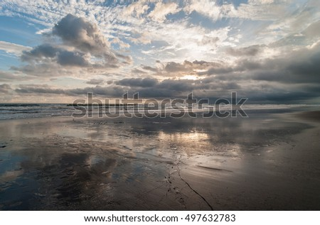 Tropical beach and cloudscape reflected on wet sand. Image taken in western Panama, Pacific coast.