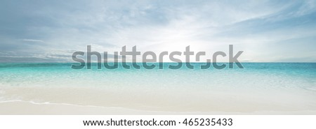 Tropical beach and ocean. Sun and clouds