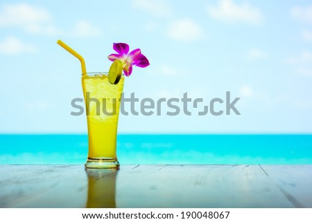 Tropical cocktail on the sea background
